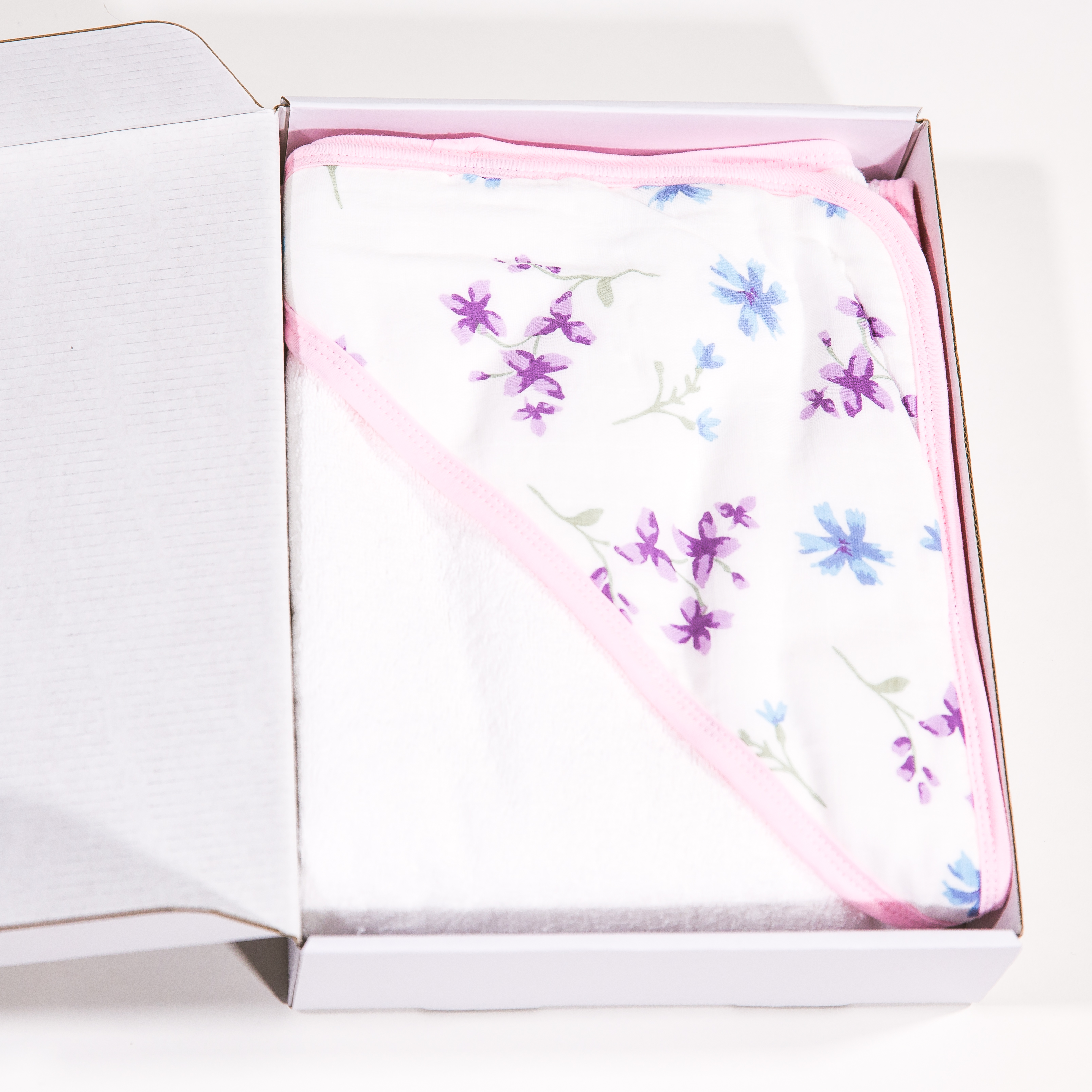 Hooded baby towel made of organic cotton flowers